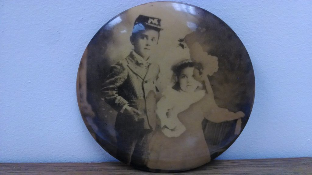 A photograph of Dad Land as a young boy with his sister.